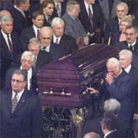 Pallbearers carrying casket